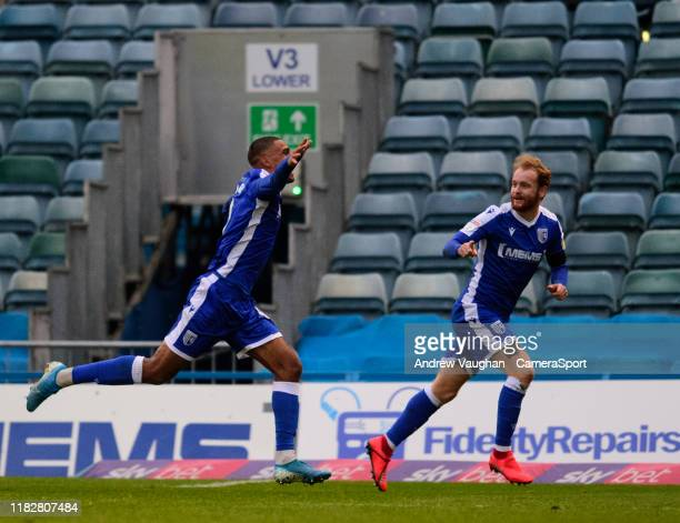 Gillingham's Mikael Mandron left celebrates scoring his side's first goal with teammate Connor Ogilvie during the Sky Bet League One match between...