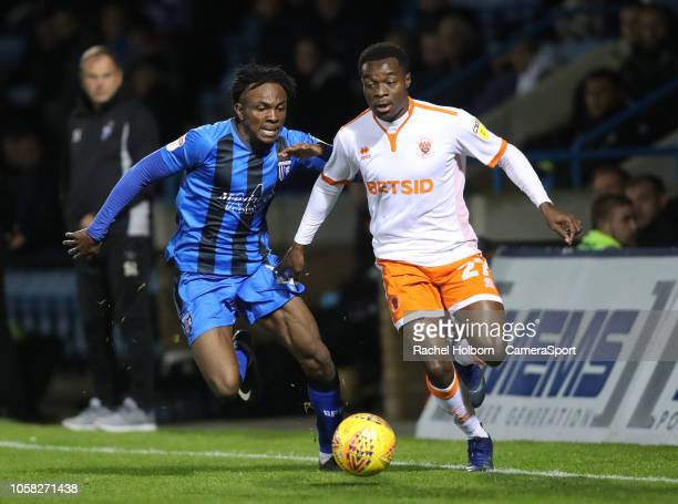 Gillingham's Regan CharlesCook and Blackpool's Marc Bola during the Sky Bet League One match between Gillingham and Blackpool at Priestfield Stadium...