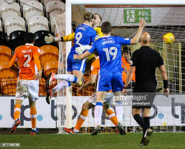 Gillingham's Tom Eaves beats Blackpool's Ryan Allsop to score his side's equalising goal during the Sky Bet League One match between Blackpool and...