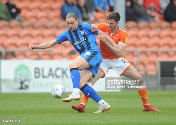 Gillingham's Tom Eaves under pressure from Blackpool's Ben Heneghan during the Sky Bet League One match between Blackpool and Gillingham at...