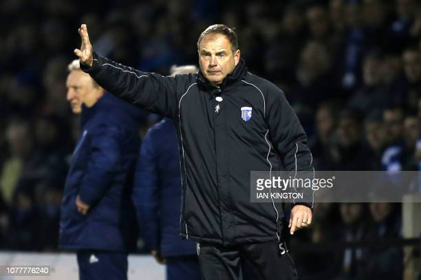 Gillingham's Welsh manager Steve Lovell gestures on the touchline during the English FA Cup third round football match between Gillingham and Cardiff...
