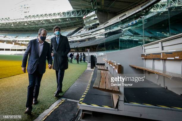 Gillon McLachlan and Victorian Sports Minister Martin Pakula leave an AFL press conference at Marvel Stadium on August 31, 2021 in Melbourne,...