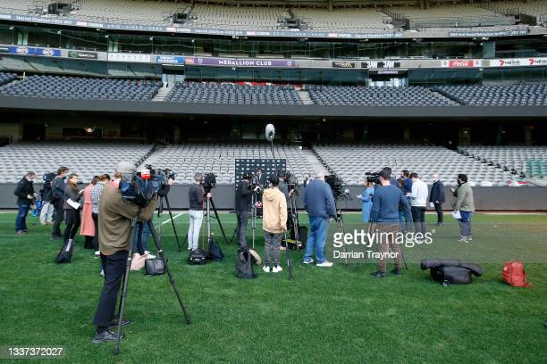 Gillon McLachlan and Victorian Sports Minister Martin Pakula speak to the media during an AFL press conference at Marvel Stadium on August 31, 2021...