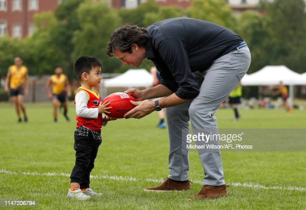 Gillon McLachlan, Chief Executive Officer of the AFL and young fan are seen during the Shanghai Cup at Wellington College on June 01, 2019 in...