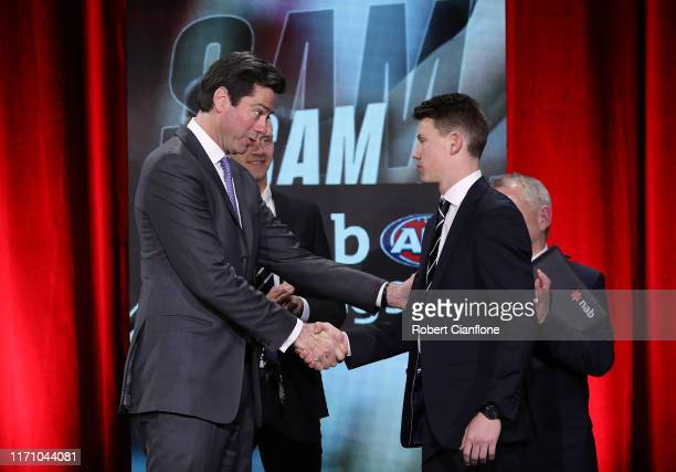 Gillon McLachlan congratulates Rising Star winner Sam Walsh of the Blues during the 2019 AFL Rising Star Award on August 30, 2019 in Melbourne,...