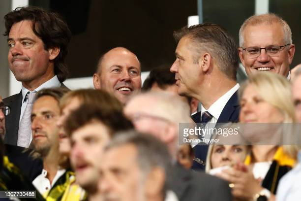 Gillon McLachlan, Federal Treasurer Josh Frydenberg and Prime Minister of Australia, Scott Morrison look on during the round one AFL match between...