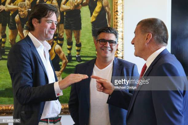 Gillon McLachlan former AFL CEO Andrew Demetriou and incoming Hawks President Jeff Kennett talk together during the book launch for 'Patrick Smith's...