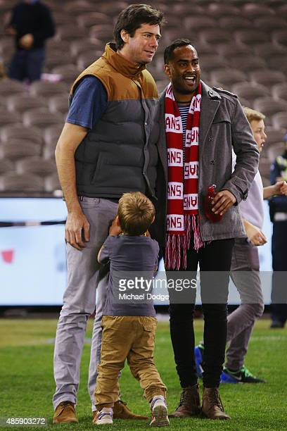 Gillon McLachlan is hit in the groin by his son Sidney McLachlan while participating in kick to kick after the round 22 AFL match between the St...