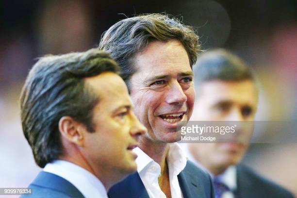 Gillon McLachlan is seen interviewed by brother Hamish McLachlan of Channel Seven during the round two AFL match between the North Melbourne...