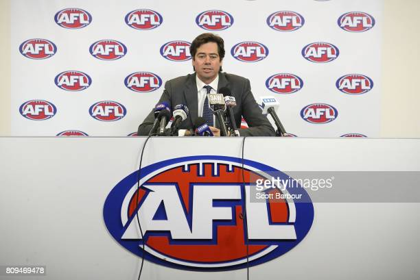 Gillon McLachlan is seen speaking at a press conference after the Northern Football League handed AFL Diversity Manager Ali Fahour a 14-week...