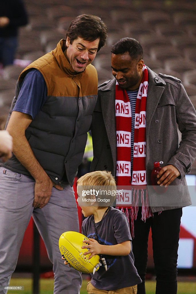 Gillon McLachlan reacts after getting hit in the groin by his son Sidney McLachlan while participating in kick to kick after the round 22 AFL match between the St Kilda Saints and the Sydney Swans at Etihad Stadium on August 30, 2015 in Melbourne, Australia.