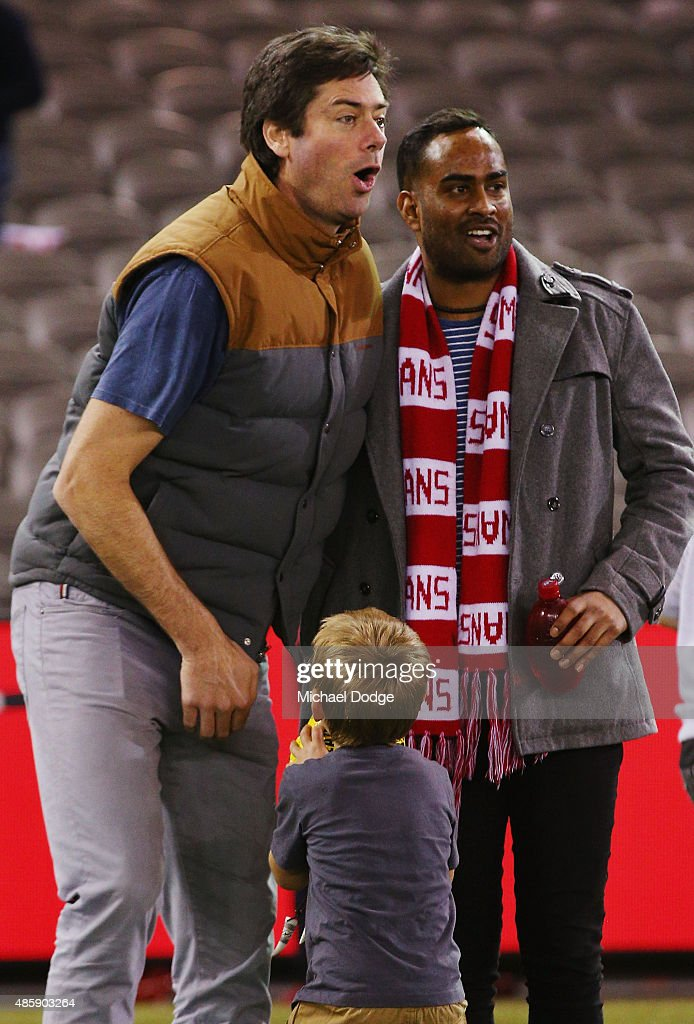 Gillon McLachlan reacts when getting hit in the groin by his son Sidney McLachlan while participating in kick to kick after the round 22 AFL match between the St Kilda Saints and the Sydney Swans at Etihad Stadium on August 30, 2015 in Melbourne, Australia.