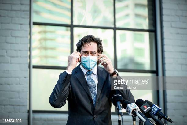 Gillon McLachlan removes his face mask before speaking to the media at Fox Sports Studio on August 25, 2021 in Melbourne, Australia.
