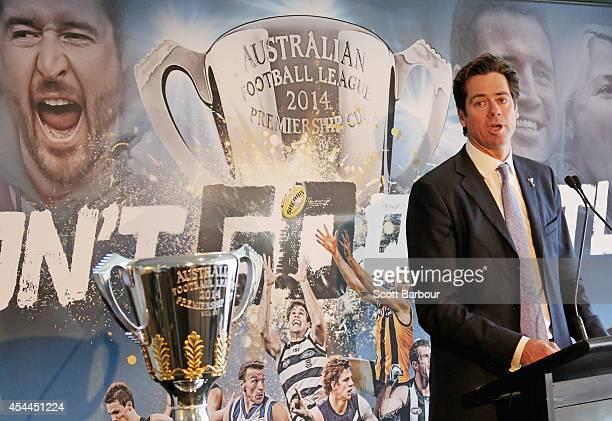 Gillon McLachlan speaks next to the 2014 AFL Premiership Cup during the AFL Premiership Cup handover on September 1, 2014 in Melbourne, Australia.