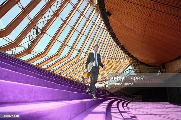 CEO Gillon McLachlan walks down stairs inside the Sydney Opera House with the 2018 AFL Premiership Cup during the NSW Celebration of the 2018 Toyota...
