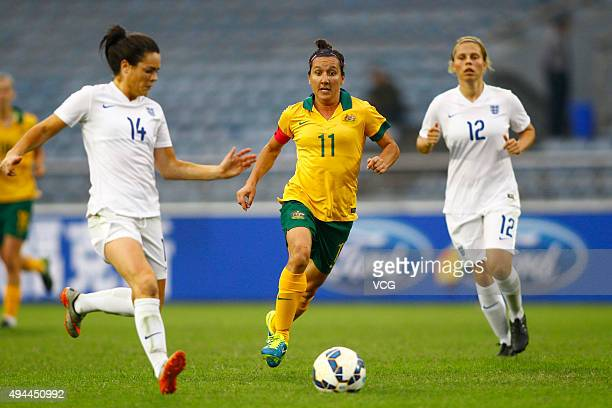 Gilly Flaherty and Claire Rafferty of England and Lisa De Vanna of Australia compete for the ball in the match between England and Australia during...