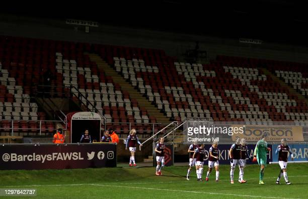 Gilly Flaherty of West Ham United leads her team out on to the pitch ahead of the FA Women's Continental League Cup Quarter Final match between West...