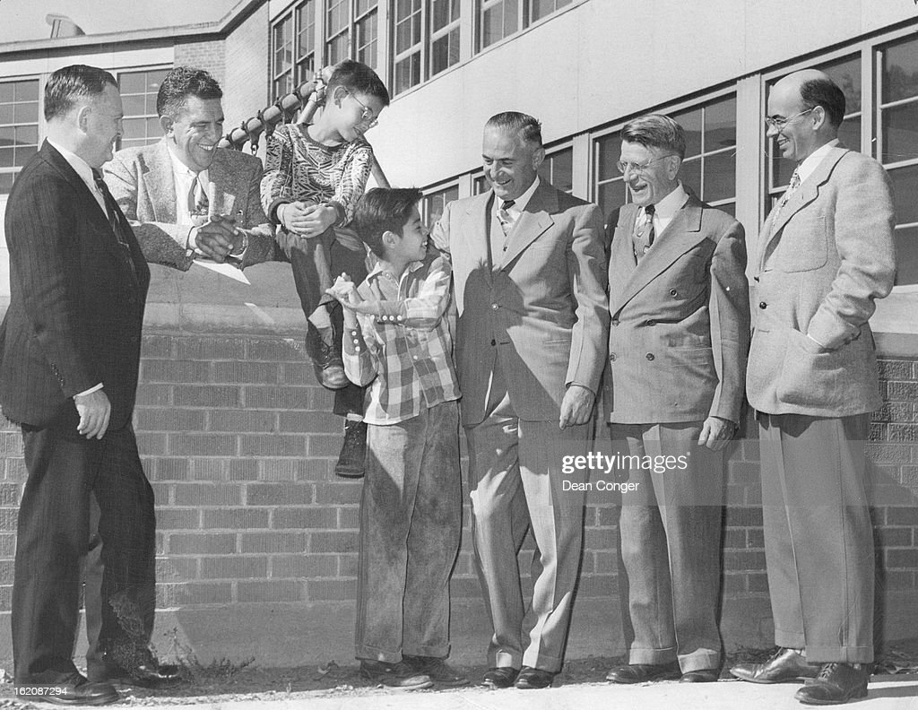 OCT 9 1952; Gilpin Elementary School; From left--Andrew Dyatt, chairman of the Rotary boys' work com : News Photo
