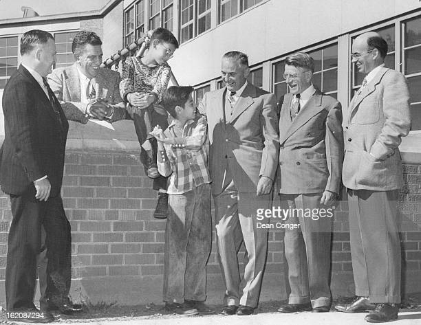 OCT 9 1952 Gilpin Elementary School From leftAndrew Dyatt chairman of the Rotary boys' work committee Tom Ewing director of Denver Boys Inc Danny...