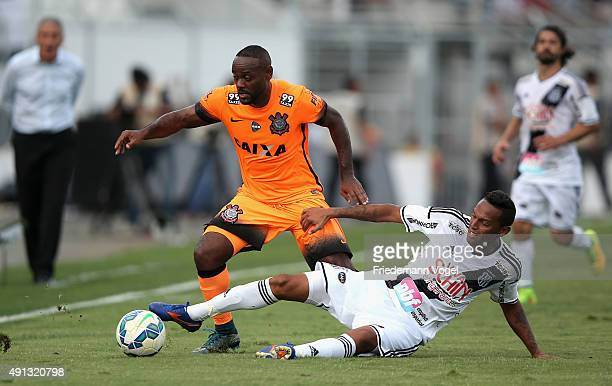 Gilson of Ponte Preta fights for the ball with Vagner Love of Corinthians during the match between Ponte Preta and Corinthians for the Brazilian...
