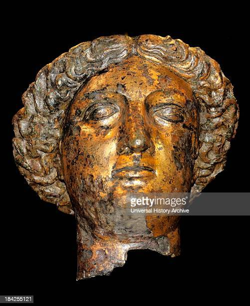 Gilt bronze head of Sulis Minerva from a cult statue in the temple at the Roman baths Circa 1st4th century AD Roman Found in Somerset England