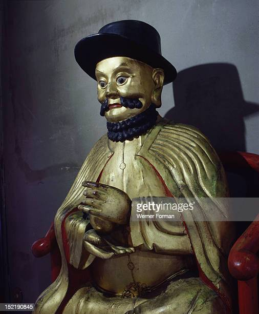 A gilt statue of Marco Polo holding a pomegranate symbol of wealth and prosperity Italy