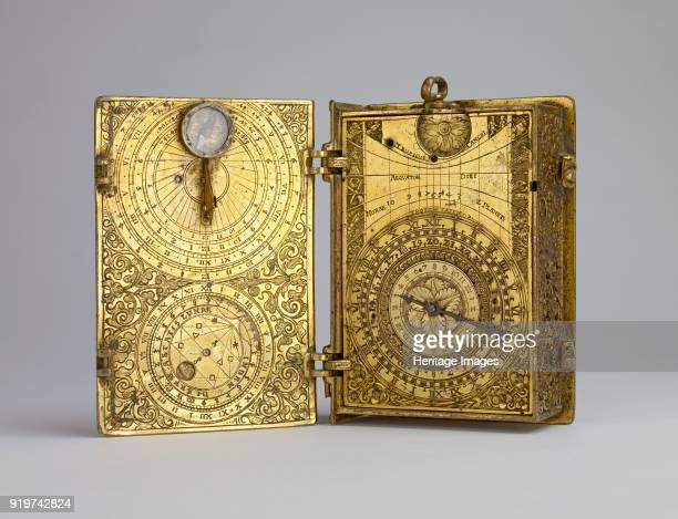 Giltbrass cased clockwatch with alarm sundials and lunar volvelle in the form of a book circa 1580 Alarm and calendar clockwatch in a deeply engraved...