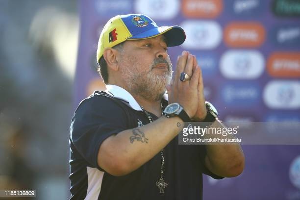 Gimnasia y Esgrima La Plata coach Diego Maradona gestures to the supporters following a match between Gimnasia y Esgrima La Plata and Estudiantes as...