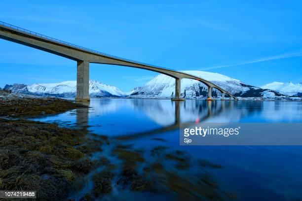 Gimsøystraumen Bridge in the Sydalspollen Fjord during sunset in the Lofoten in winter
