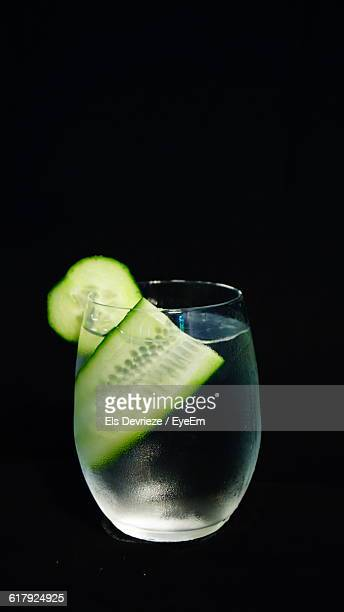 Gin And Tonic In Glass Against Black Background