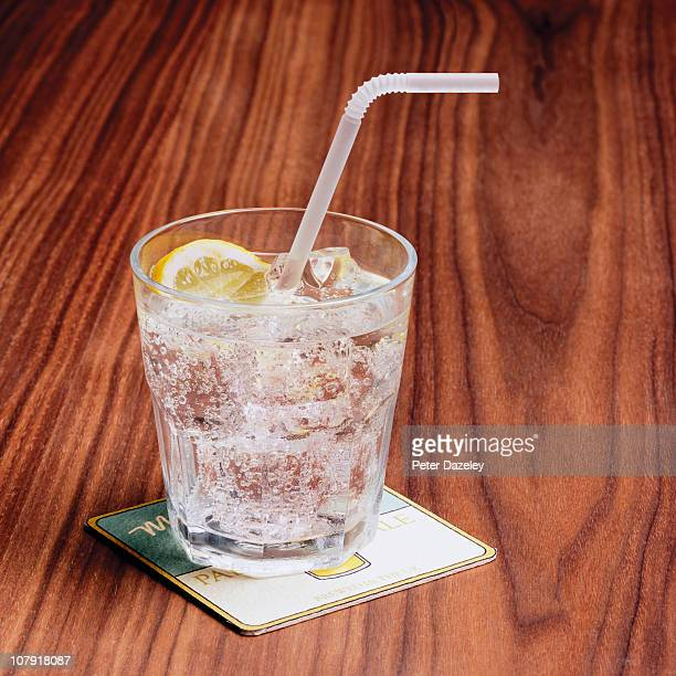 Gin and tonic on bar table