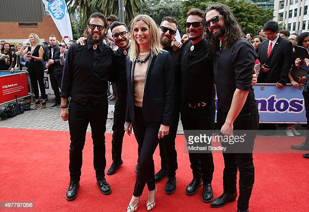 Gin Wigmore poses for photos with her band after they arrive at the Vodafone New Zealand Music Awards at Vector Arena on November 19 2015 in Auckland...