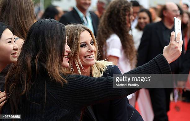 Gin Wigmore takes photos with fans after she arrives at the Vodafone New Zealand Music Awards at Vector Arena on November 19 2015 in Auckland New...