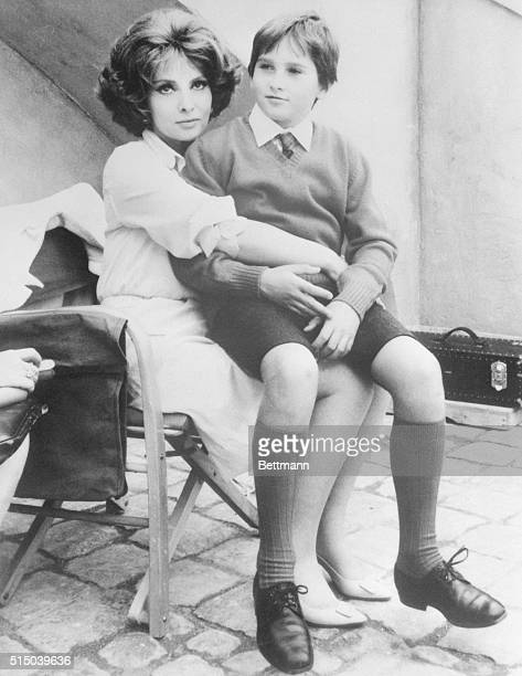 Gina as a Mother Rome Italy When is a star not a star When she's a mother like Italian beauty Gina Lollo Brigida sitting with her son Milko Jr 11...