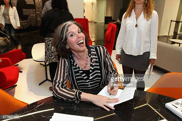 Gina Barnett signs a copy of her book during her book release party for Play the Part at GLG on June 17 2015 in New York City
