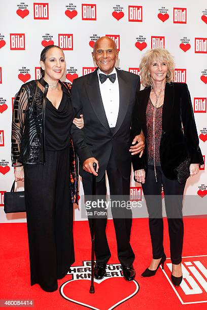 Gina Belafonte with her father Harry Belafonte and his wife Pamela Frank attend the Ein Herz fuer Kinder Gala 2014 at Tempelhof Airport on December 6...