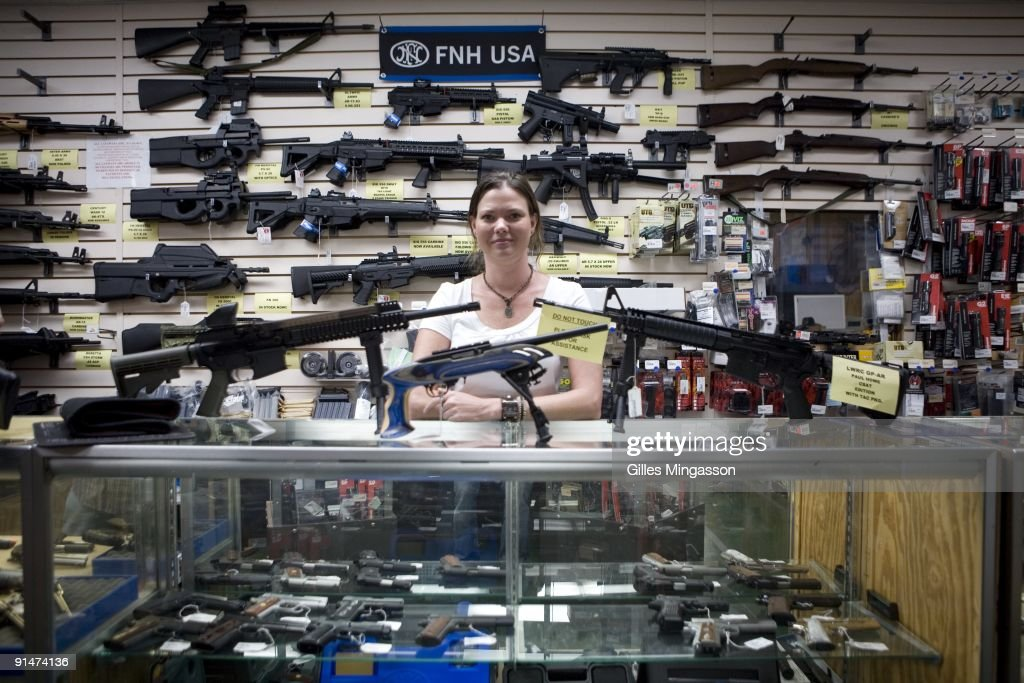 Gina Brewer, the manager Texas Gun, one of the 6,700 gun dealers located near the 2,000 miles long U.S.-Mexico border, insists that she has not sold weapons to Mexican drug cartels representatives, in San Antonio, June 17 2009. Automatic weapons such as AK-47 and AR-15 are purchased in U.S. border states by straw men (paid about $100 per weapons) working for Mexican drug cartels and smuggled into Mexico, where they fuel the narco-violence that has caused over 15,000 death since 2006. In Mexico, where gun sales are illegal, there is only one gun store, solely for police and army supplies. The ATF estimates that 90% of the 23,000 weapons seized in Mexico since 2005 come from the U.S. Following the admission by Secretary of State Hillary Clinton that the U.S. has a responsability in the narco-violence in Mexico (and fearing that it will spill into the U.S.), the ATF, Border Patrol, Homeland Security, ICE, and local police and sheriff are now trying to stem the flow of weapons into Mexico. But surprise check points inspecting vehicules heading South, in spite of hi-tech device like gas tank cameras, are easy to spot for narco-spies, and do little to slow the flow of arms into Mexico. On the Mexican side, Customs are well equiped with machines that can scan entires trucks, but they remain vulnerable to endemic corruption.
