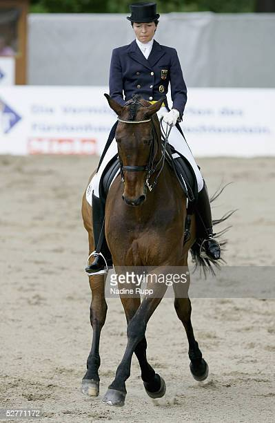 Gina CapellmannLuetkemeier of Germany rides her horse Amando to victory during the Grand Prix Kuer Martin Freiherr von Jenisch of the German Jumping...