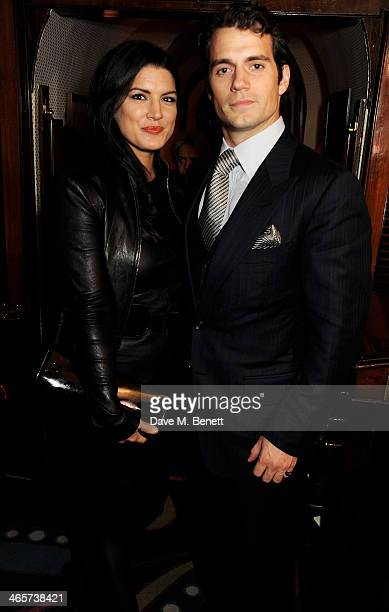 Gina Carano and Henry Cavill attend the Charles Finch and Chanel PreBAFTA cocktail party and dinner at Annabel's on February 8 2013 in London England