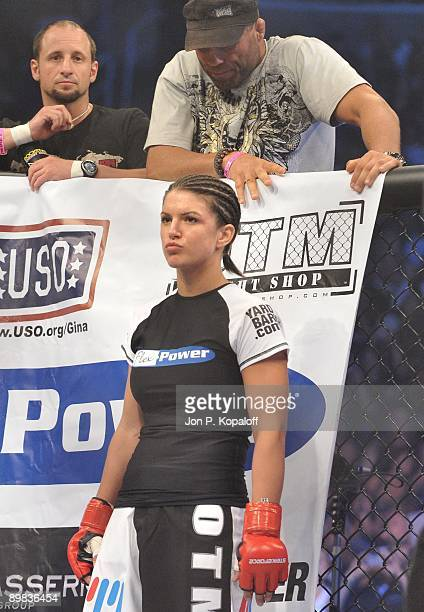 Gina Carano waits for the start of the first round against Cris Cyborg during their Middleweight Championship fight at Strikeforce: Carano vs. Cyborg...