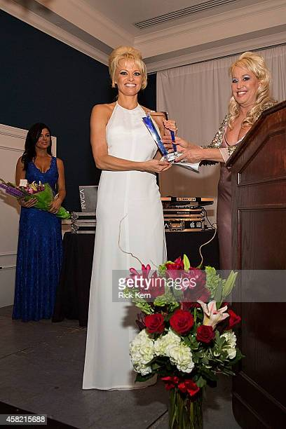 Gina de Franco executive producer and creator of the Better World Awards presents actress Pamela Anderson with an award during the 5th Annual Better...