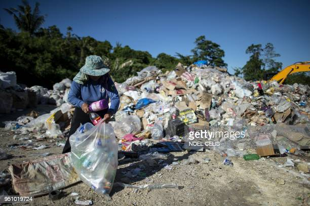 Gina Galan collects plastic bottles on the Boracay dumpsite called materials recovery facility in the Philippine island of Boracay on April 25 2018...