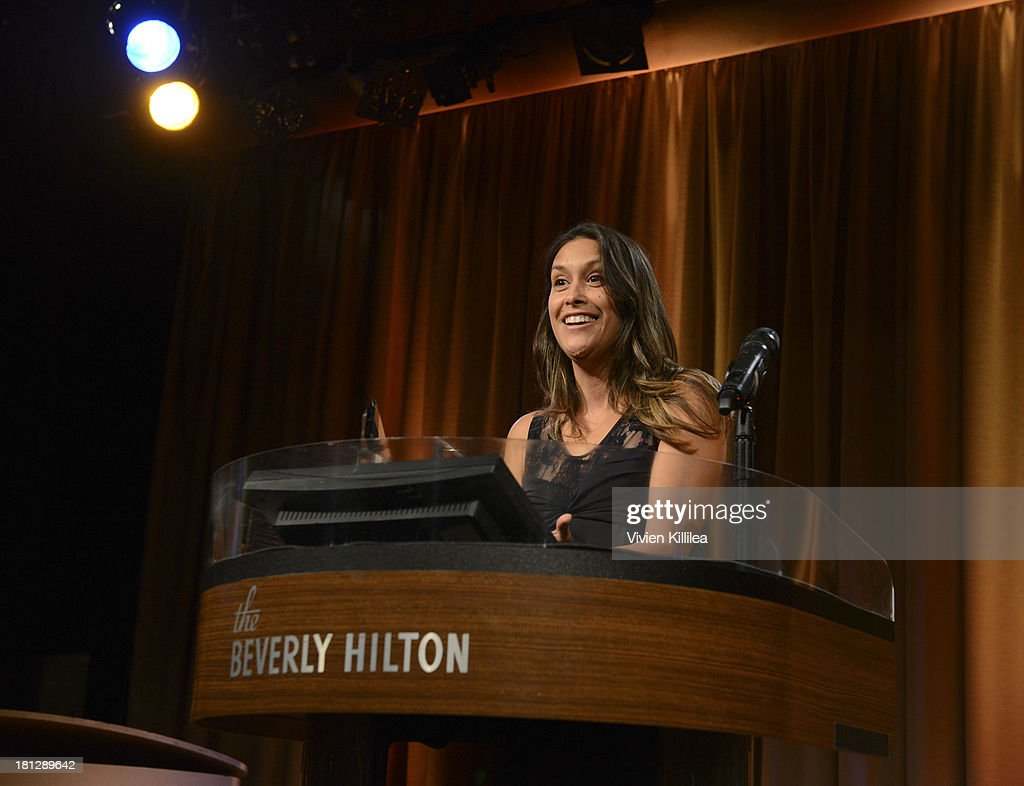 Gina Gallego receives the award for Associate Casting Director of the Year at the 12th Annual Heller Awards at The Beverly Hilton Hotel on September 19, 2013 in Beverly Hills, California.