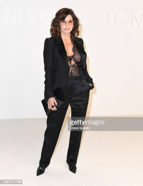 Gina Gershon arrives at the Tom Ford AW20 Show at Milk Studios on February 07 2020 in Hollywood California