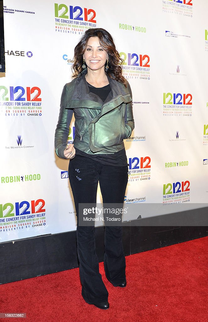 Gina Gershon attends 12-12-12 the Concert for Sandy Relief at Madison Square Garden on December 12, 2012 in New York City.