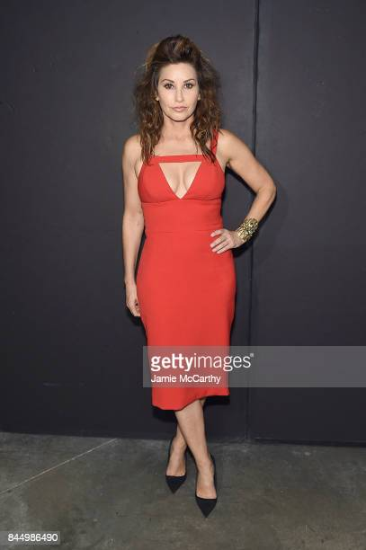 Gina Gershon poses backstage for the Christian Siriano fashion show during New York Fashion Week The Shows at Pier 59 on September 9 2017 in New York...