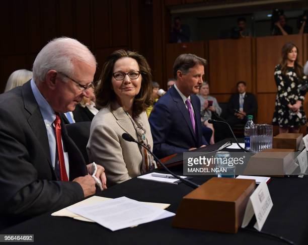 Gina Haspel arrives to testify next to former US Senator Saxby Chambliss and Sen Evan Bayh before the Senate Intelligence Committee on her nomination...