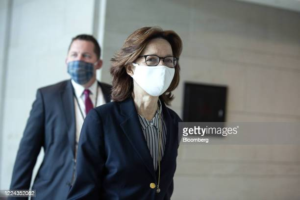 Gina Haspel director of the Central Intelligence Agency right departs a closed door briefing with other top intelligence officials at the US Capitol...