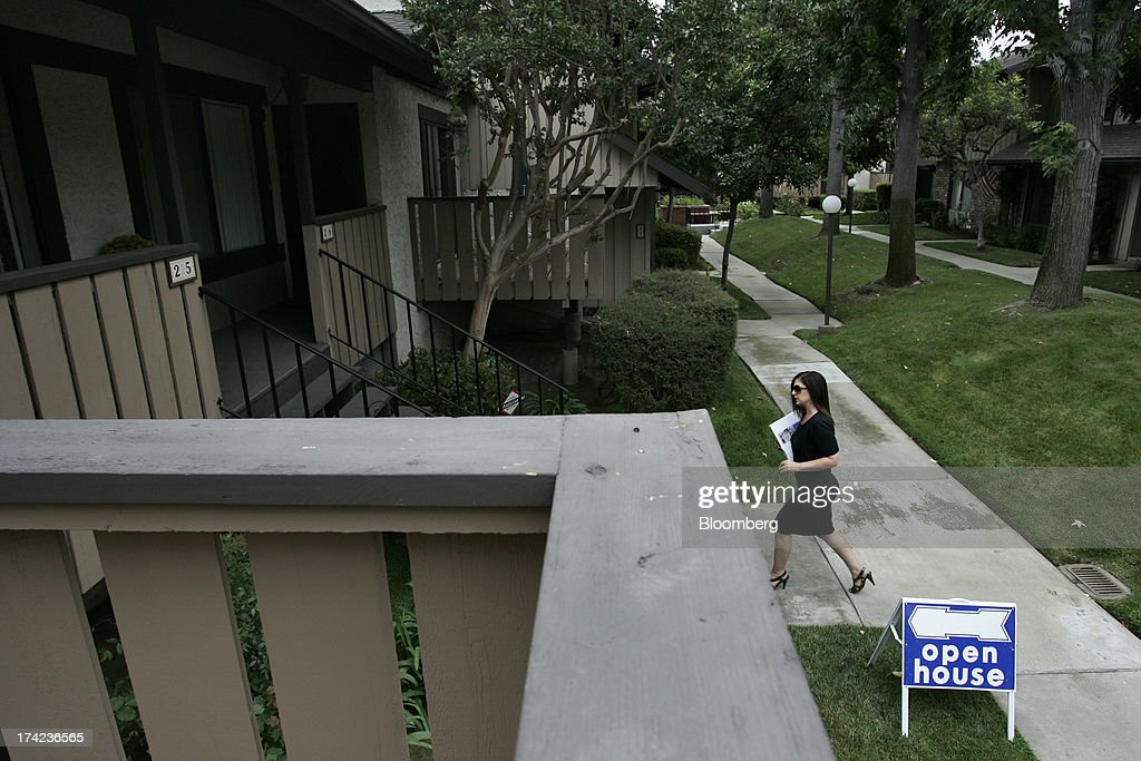 Gina Labellarti, a realtor with Coldwell Banker Dynasty TC, arrives for an open house in Arcadia, California, U.S., on Sunday, July 21, 2013. Sales of previously owned houses unexpectedly dropped in June, hurt by a lack of supply and rising mortgage rates that may slow the rebound in the U.S. real-estate market. Photographer: Jonathan Alcorn/Bloomberg via Getty Images