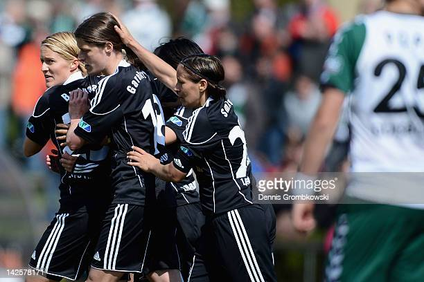 Gina Lewandowski of Frankfurt celebrates with teammates after scoring her team's second goal during the Women's DFB Cup semi final match between 1....